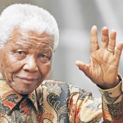 Mandela dressed in trademark Batik Shirt