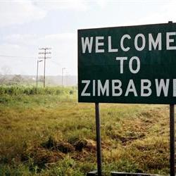 Four Zimbabwean aides officially charged