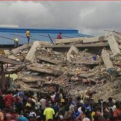 Nigeria president visits collapsed building site as death toll rises