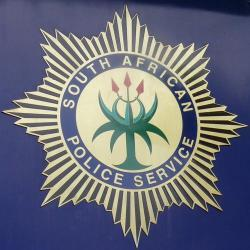 Buildings and car burn in North West gang confrontation