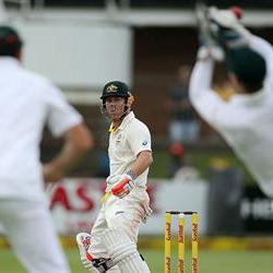 Warner questions De Villiers's glove-work