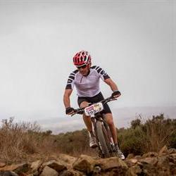 Lill and Woolcock fly the South African flag at the Cape Epic