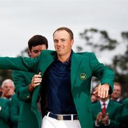 Spieth caps off a record week with a green jacket