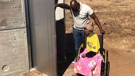 Family of seven happy after flushable pit toilet donation   News Article