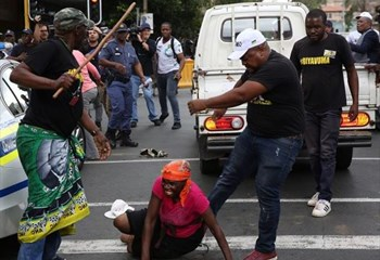 VIDEO: #ANC suspends man who assaulted woman at #LuthuliHouse march | News Article