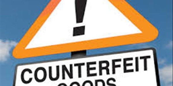 Case of counterfeit goods postponed    News Article