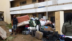 Bloemfontein evictions become heated as belongings are piled in mud | News Article